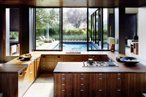 very open kitchen with a beautiful garden in the background
