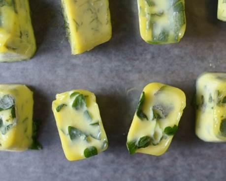 some frozen cubes of fresh herbs