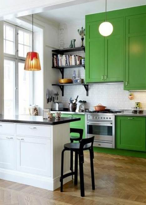 green kitchen with high ceiling