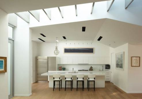 white modern kitchen with high ceilings