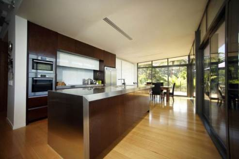 kitchen island with stainless steel countertop and dark wood