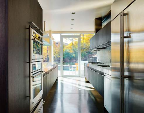 stainless steel countertops and custom wooden cabinets