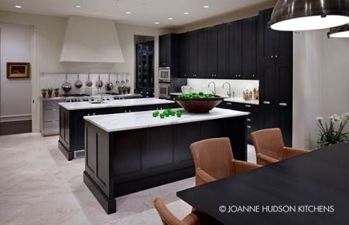 dark kitchen cabinets with white floors and countertop