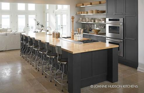 black kitchen with wooden countertop