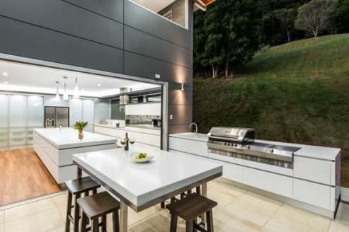 kitchen connected to outdoor kitchen