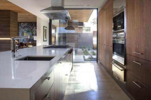 trendy kitchen with wooden cabinets