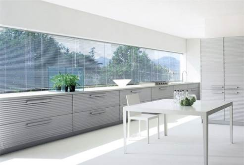modern white kitchen by schiffini