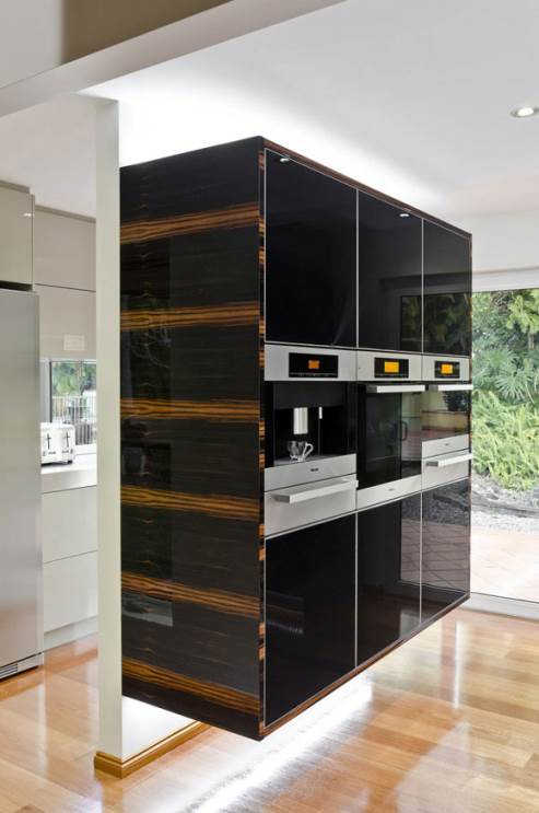 black cabinets and stainless steel Miele appliances