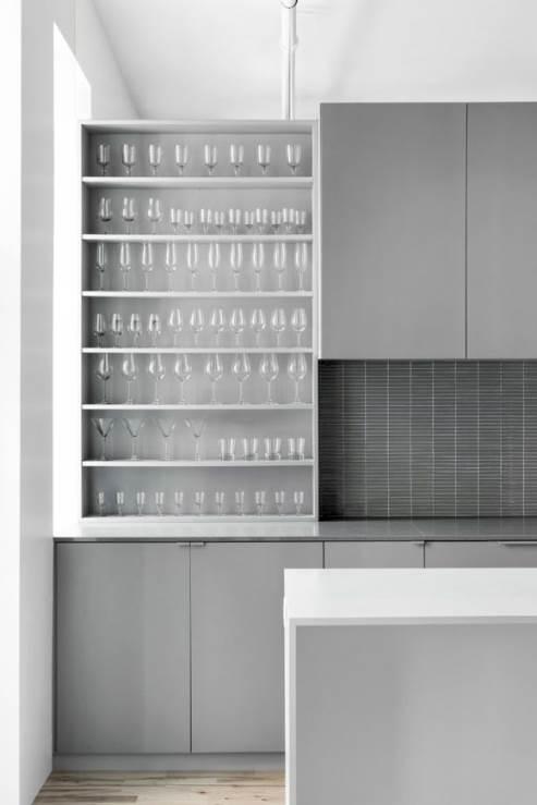 open drawers and dark tile kitchen backsplash