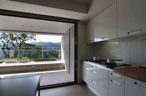 white kitchen with great view