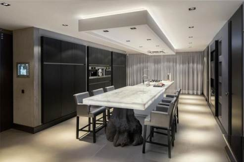sleek dark kitchen by Kolenik